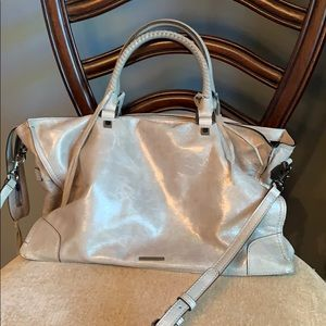 Rebecca minkoff purse has handles and a long strap